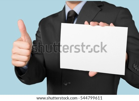 Man holds white list and thumb up.
