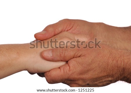 Man holds woman's hand tenderly - stock photo