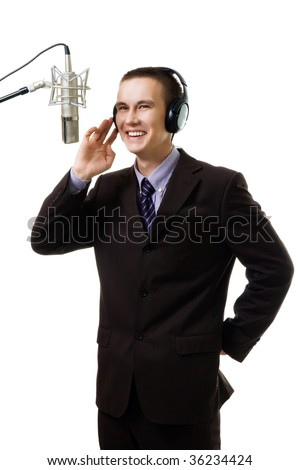 Man host at radio station speak to microphone wearing suit,isolated on white - stock photo
