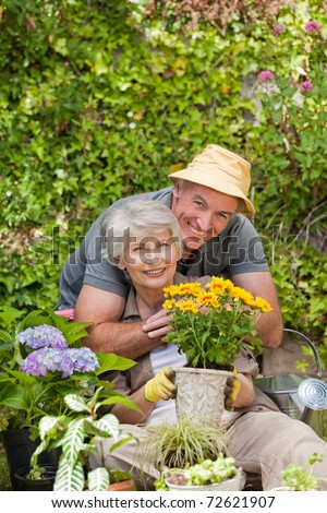 Man hugging his woman in the garden