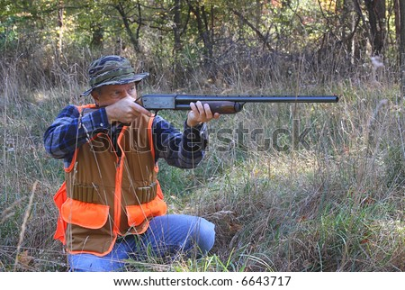 Man hunting and shooting a shot gun - stock photo