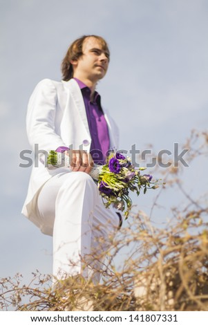 man husband , groom whith beautiful wedding bouquet - stock photo