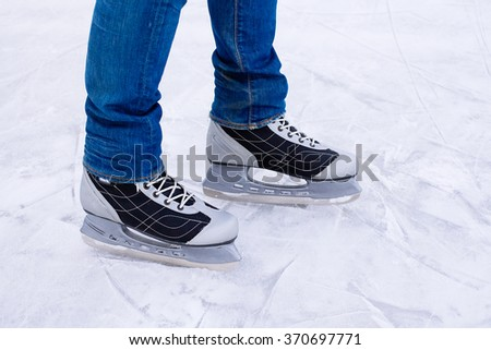 Man ice skating. winter outdoors on ice rink. ice and legs - stock photo