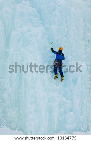 Man iceclimbing in a frozen waterfall
