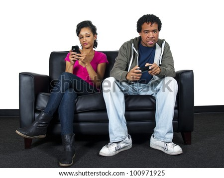 man ignoring girlfriend while playing video games - stock photo
