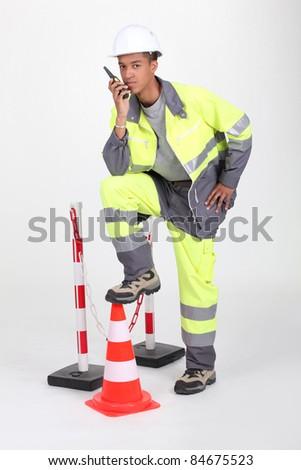 Man illustrating roadworks - stock photo
