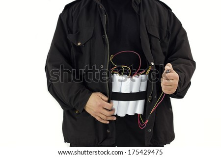 man in a black jacket strapped with explosives and detonator holds in his hand,best focus on the hands and the detonator, jacket soft focus - stock photo