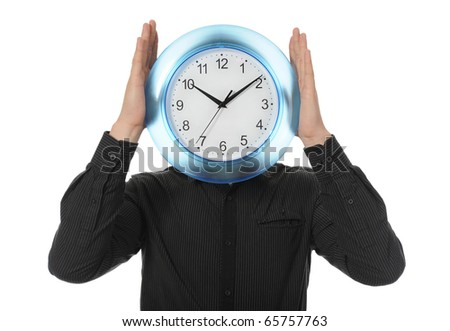man in a black shirt holds clock