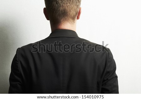 man in a black suit.without face.stylish businessman.man in the suit on white.mens back - stock photo