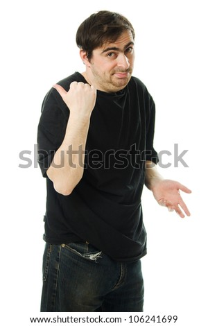 man in a black T-shirt points a finger behind his back on white background - stock photo