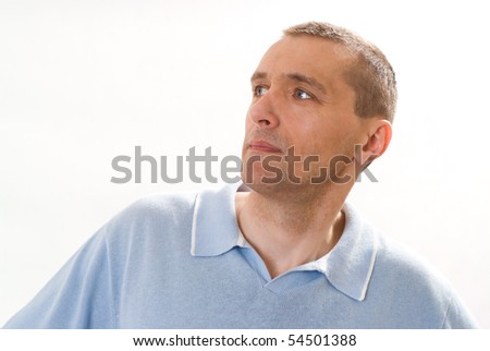 man in a blue shirt standing on a white - stock photo