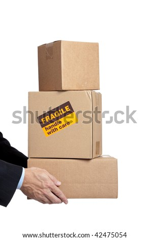 Man in a business suit holding boxes with a fragile sticker on it on a white background - stock photo