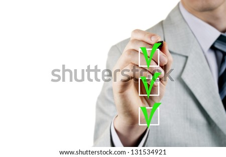 man in a business suit, put a check as a sign of quality - stock photo