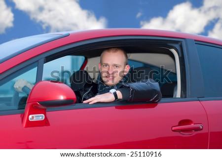 man in a car - stock photo