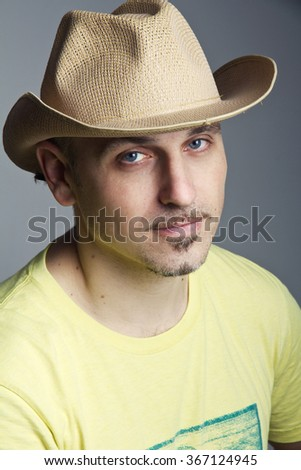 Man in a cowboy hat a weary expression on his face - stock photo