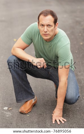 Man in a crouching pose - stock photo