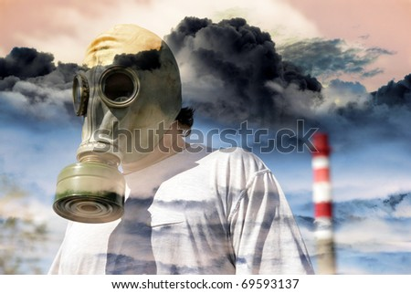 Man in a gas mask against a pipe polluting air