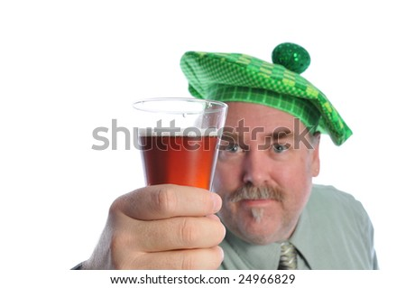 Man in a green hat with a beer - stock photo
