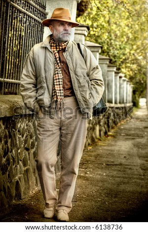 Man in a hat having a walk - stock photo