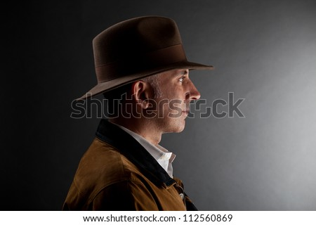 Man in a hat looking at the light