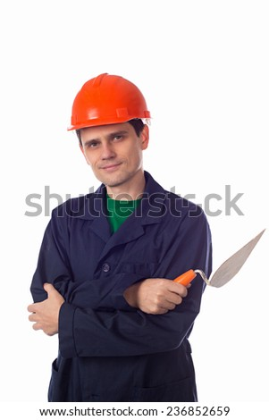 man in a helmet and  blue robe holding building trowel arms folded - stock photo