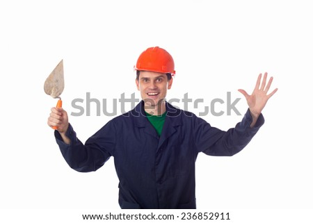 man in a helmet and storitelnoy blue robe holding building trowel , hands up - stock photo