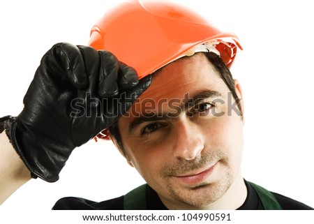 man in a helmet shows a gesture of welcome on white background. - stock photo
