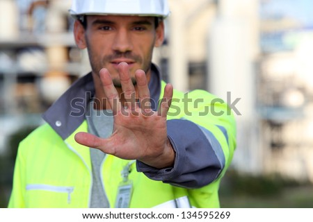 Man in a high visibility jacket - stock photo