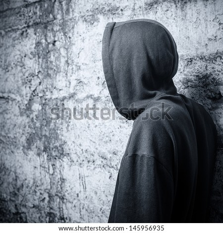 Man in a hooded sweatshirt. View from the back - stock photo