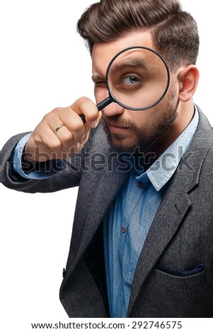 Man in a jacket with magnifying glass isolated on white background