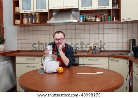 Man in a kitchen with food processor