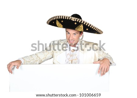Man in a mariachi costume  with a board left blank for your  message - stock photo