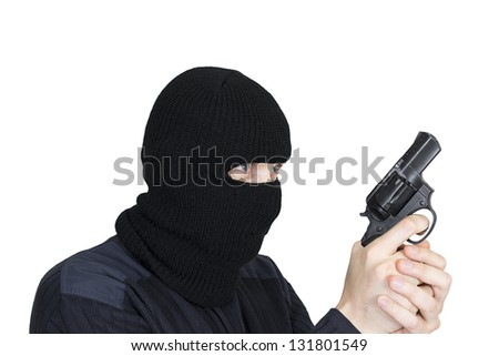 man in a mask with a gun on a white background - stock photo