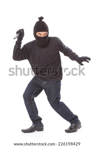 Man in a mask with a knife on a white background  - stock photo