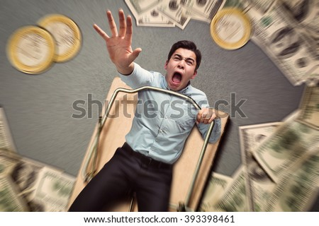 Man in a mouse trap falling - stock photo