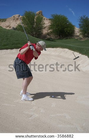 Man in a sand trap - stock photo