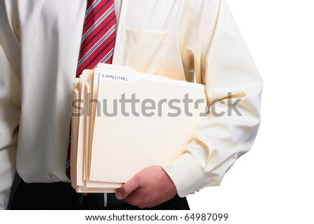 Man in a shirt and a tie holding a manila competitors folders. Add your text to the folder. - stock photo