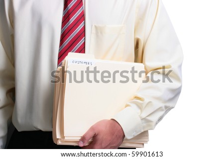 Man in a shirt and a tie holding a manila customers folder. Add your text to the folder. - stock photo