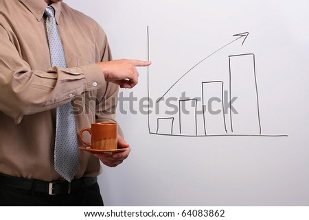 Man in a shirt and a tie holding a plate and a cup while pointing to a drawing of a bar graph. - stock photo
