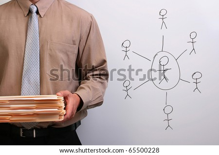 Man in a shirt and a tie holding a stack of manila folders. - stock photo