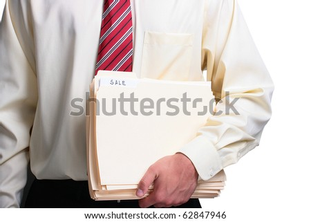 Man in a shirt and a tie holding sale folders. Add your text to the folder. - stock photo