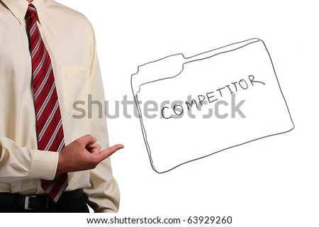 Man in a shirt and a tie pointing at a drawing of a competitor folder. - stock photo