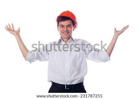 Man in a shirt in orange construction helmet, throws up his hands; isolated Background