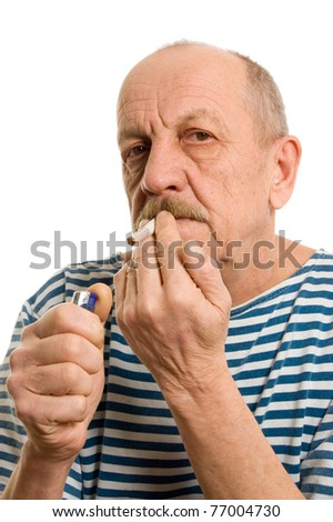 Man in a stripped vest smokes - stock photo