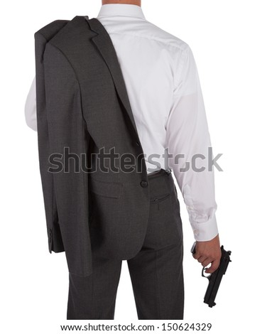 Man in a suit holding a gun viewed from behind isolated on white - stock photo