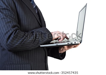 man in a suit holding a laptop