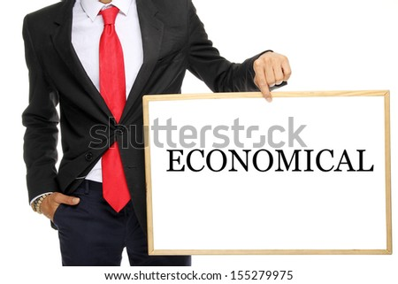 Man in a suit holding a white board