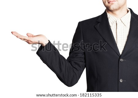 man in a suit holding something in his hand