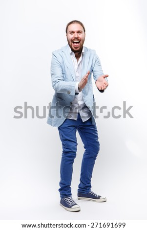 man in a suit on a white background, claps, applauds, rejoice, happiness, hello, attracts - stock photo