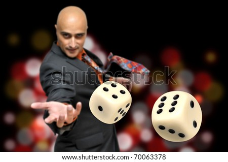 Man in a suit playing dice - stock photo